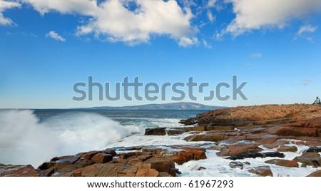 Acadia national park, crashing waves into the shoreline at schoodic head area. - stock photo