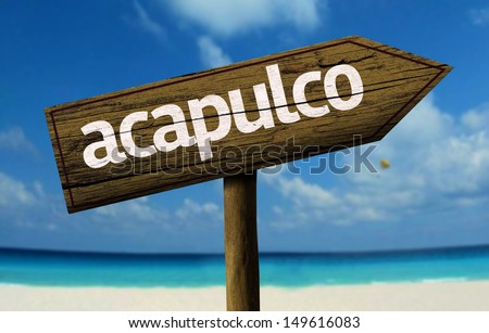 Acapulco wooden sign with a beach on background - stock photo