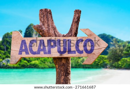 Acapulco wooden sign with beach background - stock photo