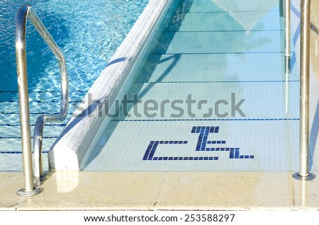Access to swimming pool for with handicapped symbol - stock photo