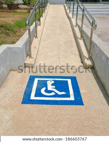 accessible disabled sign on pathway - stock photo