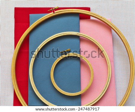 Accessories for embroidery: tambours and  different types of canvas - stock photo