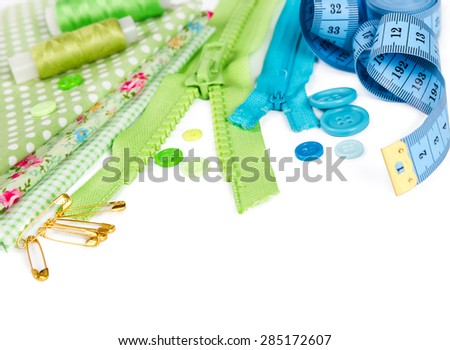 Accessories for sewing - fabric, pins, zipper, thread, buttons and measuring tape isolated on white background - stock photo