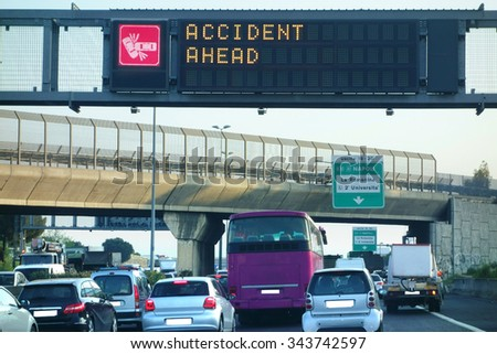 Accident Ahead Warning Traffic jam during rush hour - stock photo
