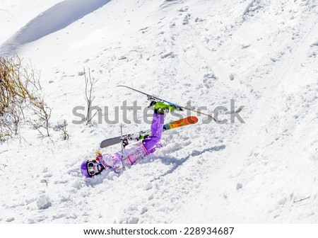 Accident at the ski resort. Little girl falls in soft snow off piste - stock photo