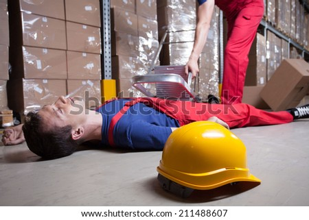 Accident during work at height in factory - stock photo