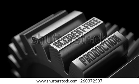 Accident-Free Production on the Metal Gears on Black Background.  - stock photo