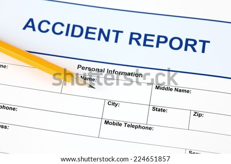 Accident report application form with pencil. - stock photo