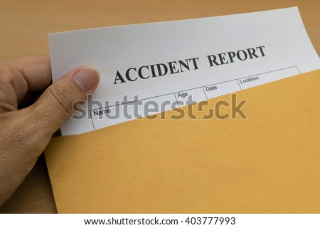 Accident report form on brown envelope  - stock photo