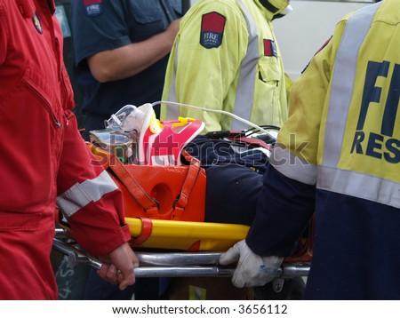 Accident Victim on Stretcher - stock photo
