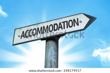 Accommodation sign with a beautiful day - stock photo