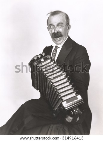 Accordion player - stock photo