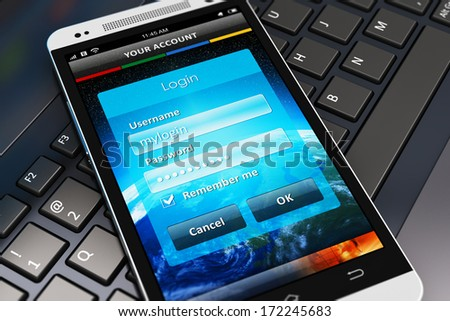 Account authorization interface window with login and password input fields on modern black glossy touchscreen smartphone on laptop or notebook computer PC keyboard with selective focus effect - stock photo
