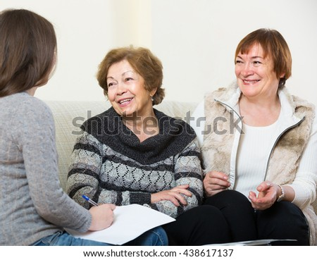 account manager helping positive american elderly women with finances at home - stock photo