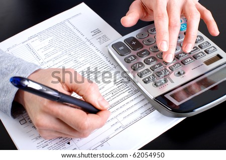 Accountant filling the forms out. - stock photo