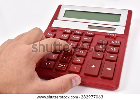 accountant hand pushing red calculator, close up - stock photo