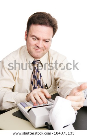 Accountant looking over the numbers and smiling with satisfaction.  White background.   - stock photo