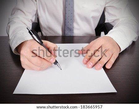 accountant working with blank paper on table - stock photo
