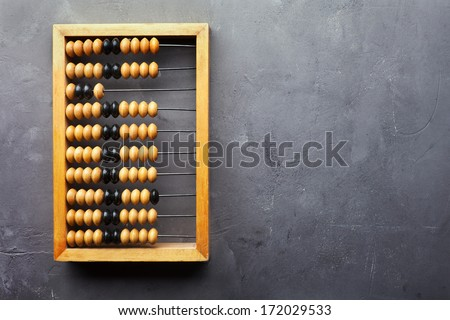 Accounting abacus on gray textured background with copy space - stock photo
