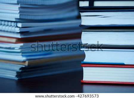Accounting and taxes. Large pile of magazine, notebook and books closeup - stock photo