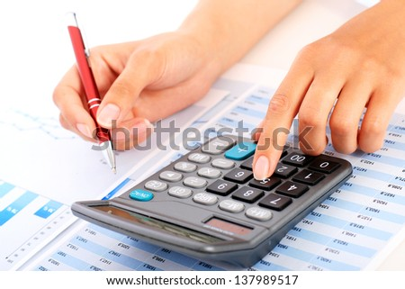 Accounting concept. Hands, pen and calculator. - stock photo