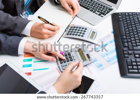 Accounting. Hand with calculator. Finance and accounting business. - stock photo