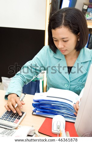 accounting staff working on receipt with calculator - stock photo