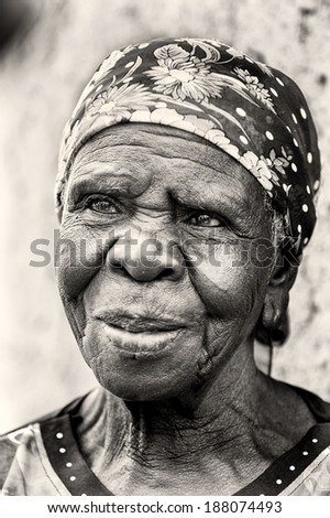 ACCRA, GHANA - MAR 5, 2012: Unidentified Ghanaian old woman sclose up. People of Ghana suffer of poverty due to the difficult economic situation - stock photo