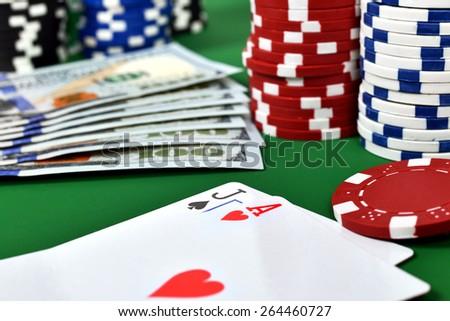 Ace, jack, poker chips and money - stock photo