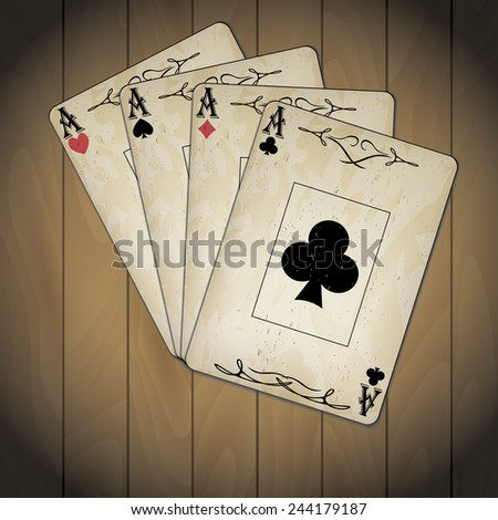 Ace of spades, ace of hearts, ace of diamonds, ace of clubs poker cards set old look varnished wood background - stock photo