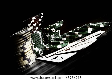 aces high on the table with chips - stock photo