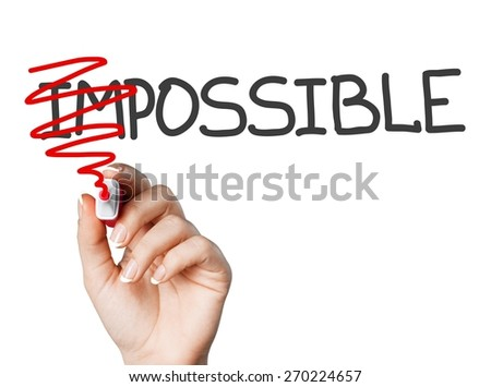 Achievable. Hand turning the word Impossible into Possible with red marker isolated on white. - stock photo