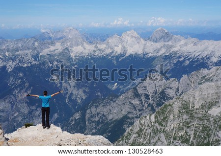 Achievement of a happy hiker on a mountain edge - stock photo