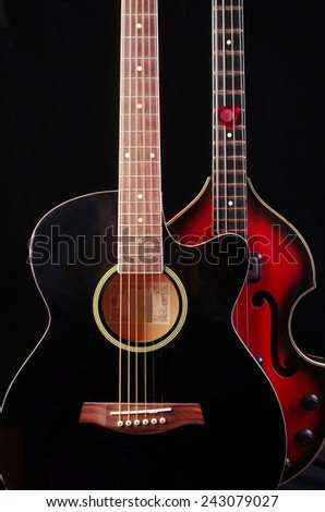 Acoustic and bass guitars on black - stock photo