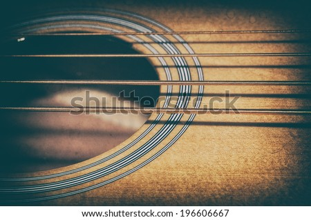 Acoustic Bass Strings and Sound Hole. The strings and sound hole of an acoustic bass guitar. - stock photo