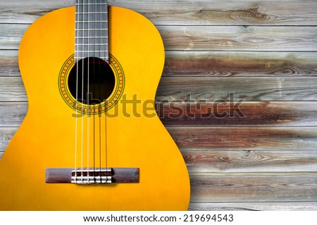 acoustic, classical guitar on the old wood texture - stock photo