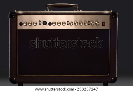 acoustic guitar amplifier on the dark background - stock photo