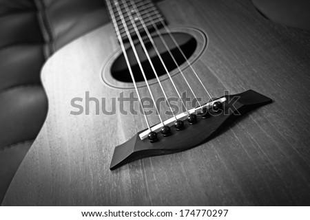 acoustic guitar bridge closeup B&W film processed - stock photo