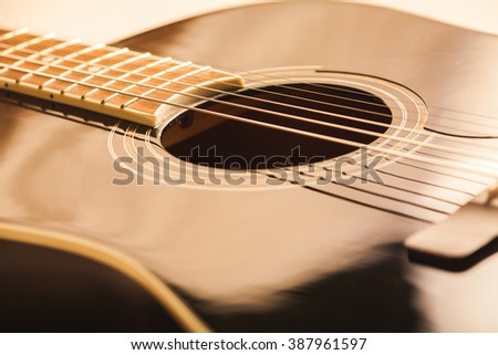 acoustic guitar close-up shot - stock photo
