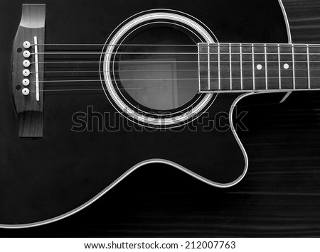 Acoustic Guitar in black and white the music room - stock photo
