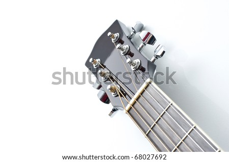 Acoustic guitar neck close-up on a white background. - stock photo
