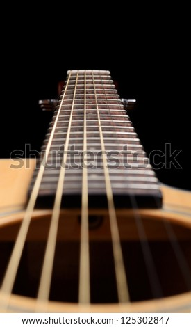 Acoustic guitar on a black background - stock photo