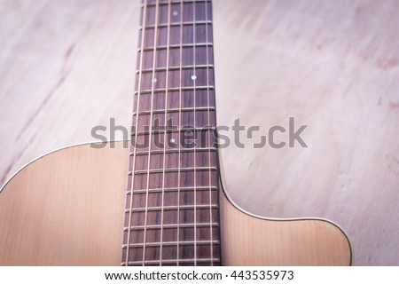 acoustic guitar on wooden table old colour - stock photo