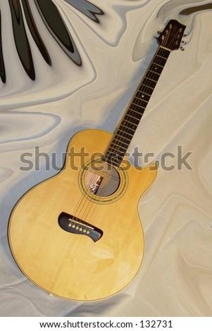 Acoustic six stringed guitar over taffeta - stock photo