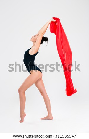 Acrobat woman in gymnast suit posing isolated on a white background - stock photo