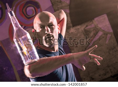 Acrobatic Barman in Action - Freestyle american Bartender - stock photo