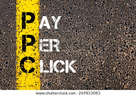 Acronym PPC - Pay Per Click. Business Conceptual image with yellow paint line on the road over asphalt stone background. - stock photo