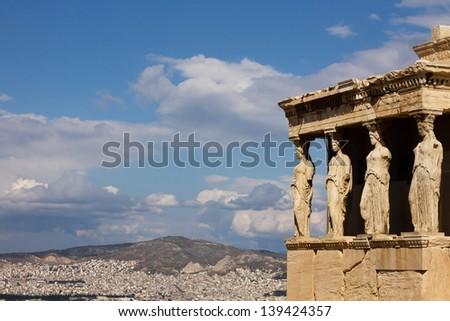 Acropolis, Erectheion, caryatids in Athens with panoramic view of the city, Greece - stock photo