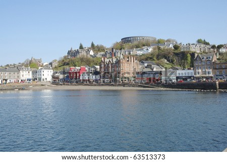 across the harbour to McCaigs Folly at Oban in the West Highlands - stock photo