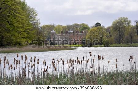 Across the lake, Blickling Hall stately home on the Blickling Estate in Norfolk, UK. - stock photo